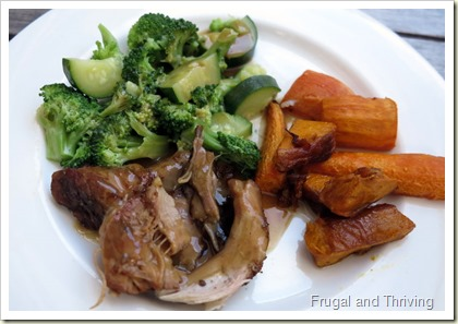 Pork shoulder with roast vegetables and gravy