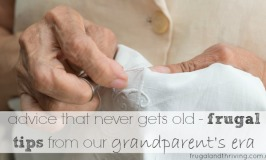 Hands of an elderly woman sewing
