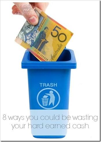 rubbish bin with money