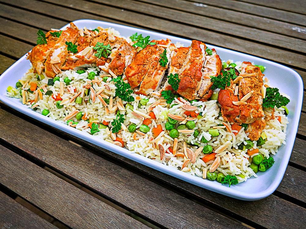 tandoori chicken and rice plated