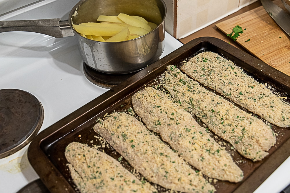fish and chips ready to be baked in the oven.