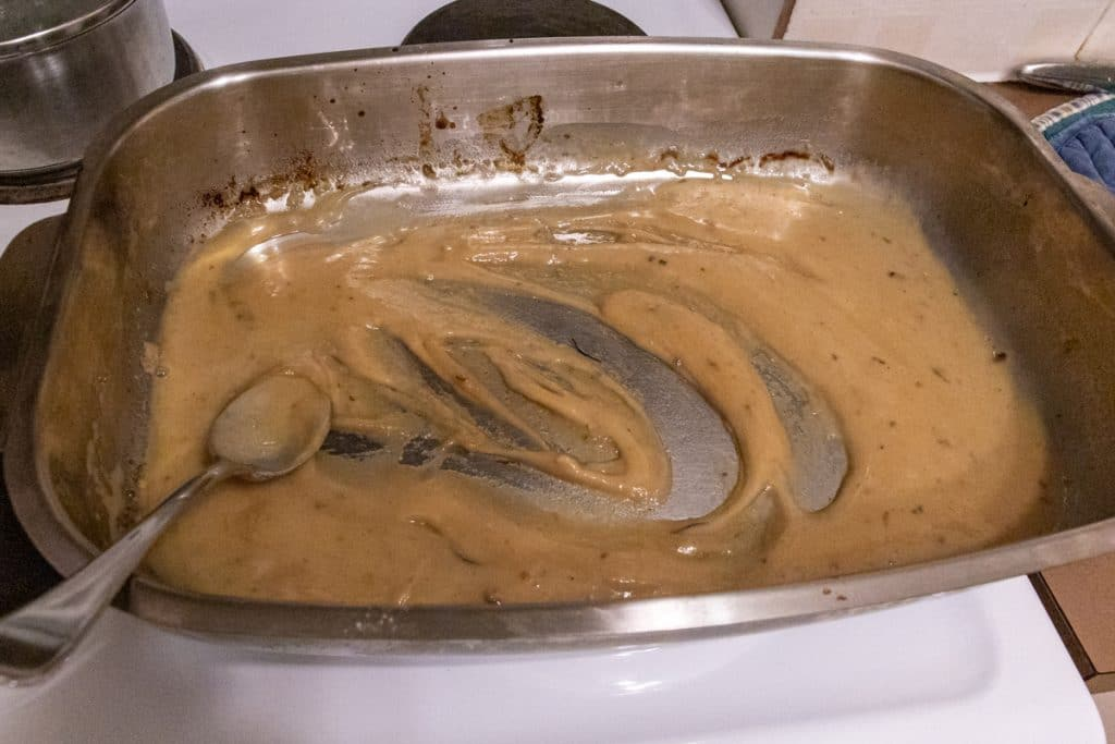 add stock to gravy and mix to prevent lumps