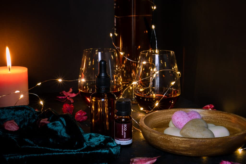 romantic atmosphere at home with wine, fairly lights, candle, essential oils, massage oils, chocolate